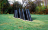 Untitled, view 3, ©1977<br>Precast concrete with integral color. &lt;br&gt;&#xA;54h x 48w x 216d (inches) &lt;br&gt;&#xA;Photo by unknown &lt;br&gt;&#xA;Private commission, Gladwyne, Pennsylvania