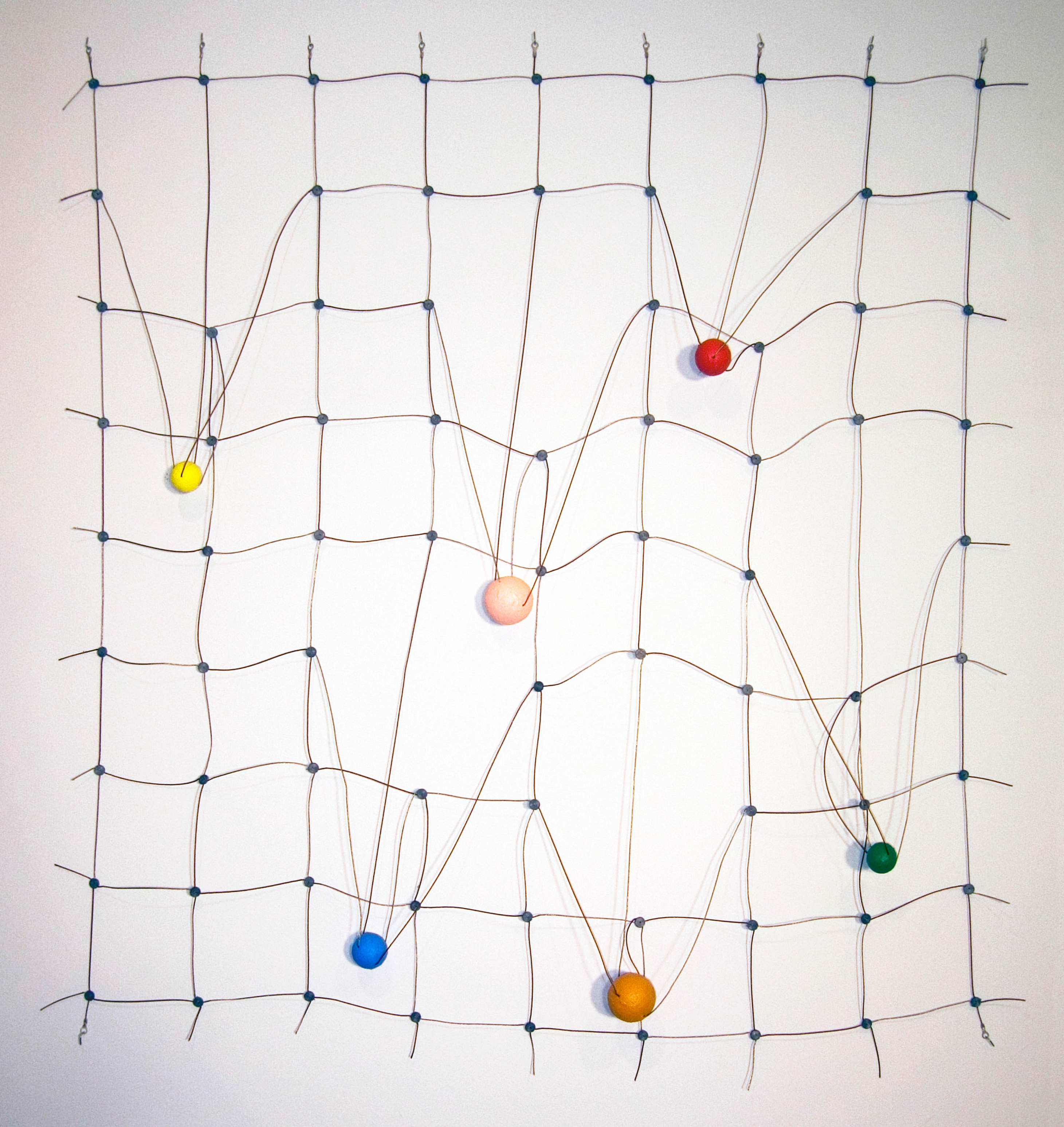 Catawampus, ©2005<br>Monel wire rope, Phosphor bronze wire rope, lead seals, ring terminals wood and acrylic paint. &lt;br&gt;&#xA;45h x 41.5w x 3d (inches) &lt;br&gt;&#xA;Estate of Charles Fahlen &lt;br&gt;&#xA;Exhibited: Steven Wolf Fine Arts, 2008